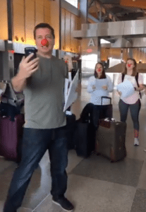 Our fearless leader donned a red nose to tell us all that we were headed to … Paris!